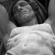statue of male chest and face
