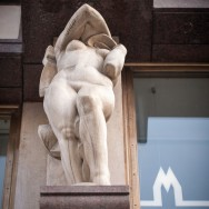 nude statue with waveform nearby