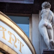 Restaurant sign in art deco font with nude statue