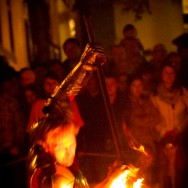 Man with flaming sword at night wins battle