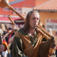 Man in period costume playing bagpipes
