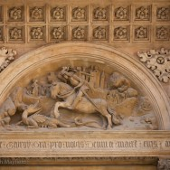 Frieze above archway of Saint George slaying the dragon