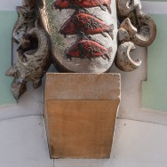 Three fishes above door