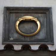 ring sculpture above door