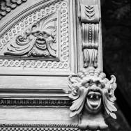 stylized face on door archway