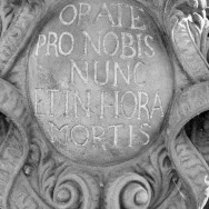 Detail of inscription of statue on Charles Bridge