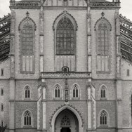 Front facade of Saint Barboras Cathedral in Kutna Hora. Tourist in Foreground.