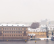 panorama of Prague river in snow.